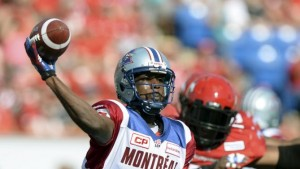Montreal Alouettes' quarterback Cato passes the football during their CFL football game against the Calgary Stampeders in Calgary